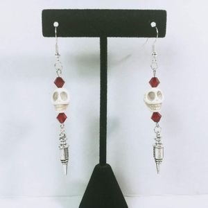 Skull and needles earrings with red glass beads